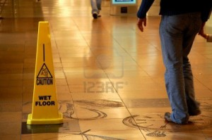 5225643-caution-wet-floor-sign-in-a-shopping-mall